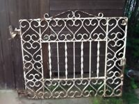 Two wrought iron gates for driveway and six fences to match. Needs attention.