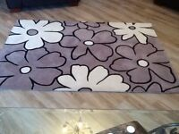Taupe,Cream and Black rug.