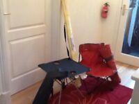 Chair, table, plus windbreaker