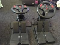two sets of v3 steering wheels and foot pedals for playstation