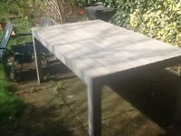 Large garden table selling cheap due to moving seats about 8