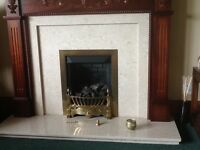 Gas fire in working order and mahogany surround with marble hearth and back panel