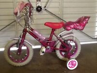 Girl's bike with stabilisers, helmet and bag