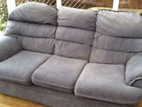 Three seater blue sofa