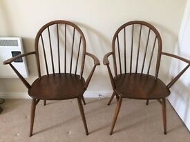 ERCOL. PAIR OF CARVER CHAIRS