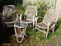 Cane armchairs and table