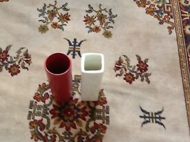 A pair of vases, one Beige the other is Red.