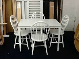 £99 - white 110cm table with 4 chairs - new and unused - delivery available