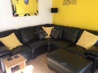 5 seater black corner sofa & large foot stool