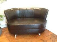 Brand new black leather suite. Two, 2 seater sofas and 1 armchair.