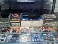boxed slimline ps3 500gb with 68 games and 3 original pads