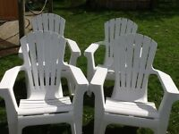 Four plastic garden chairs