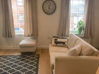 Selling x2 cream 2 seater sofas and matching footstool