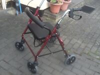 Mobility aide walker with padded seat,basket beneath and brakes
