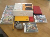 Yellow Nintendo DSi XL with peri stalled Brain Training, travel case and 5 games