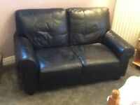 Two seater black leather settee in very good condition