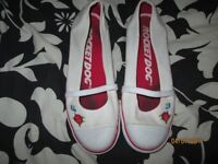 ROCKET DOGS SIZE 7 WHITE WITH ROSE AND BIRD LOGO ON RED HAS RUN ON WHITE BUT NOT NOTICEABLE