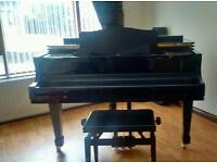 Lippmann baby grand piano with stool