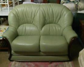 Very Smart Two Seater Green Leather Sofa