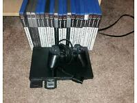 Playstation 2 (PS2) with 18 games