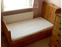 Cot/junior bed in solid Pine, mattress included, minimal use as at grandparents house.