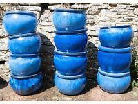 11 Vietnamese- style outdoor planting pots.
