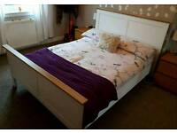 White wooden king size bedframe and mattress