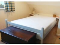 Light grey, pine double bed very comfortable foam mattress easy to dismantle and move