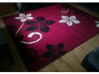 Large red white and black rug