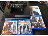 Ps4 with 4 games for sale