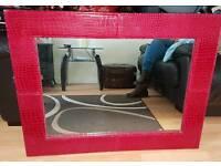 Red framed mirror