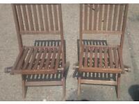 Pair of folding wooden garden chairs