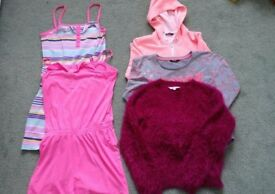 Age 11-12 years girls clothes bundle. Includes 3 tops and 2 top and shorts in one. £4