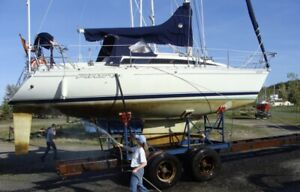 Beneteau First 305 with yard trailer
