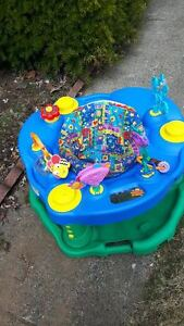 Saucer with lots of toys - Great and in clean condition