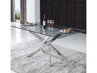 Stunning glass and steel dining table