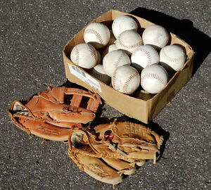 Two Baseball Gloves and Balls