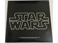Star Wars Soundtrack Albums x 3, including poster and rare promo copy of ROTJ with spelling mistake