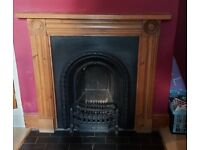 Cast iron fireplace and wooden surround
