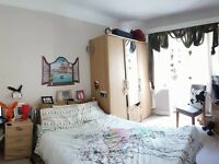 Large furnished double bedroom with balcony in huge flat views over gardens