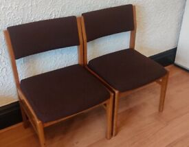 Pair of comfortable wooden chairs.