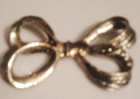 New Gold Toned Bow Pendant.