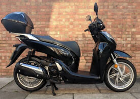 Honda SH300 (17 REG) in black, Immaculate Condition with only 2838 miles!