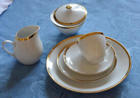 Tea Service with 6 cups saucers and plates, milk jug, sugar basin, cake plate. Lovely quality.