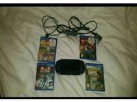 Playstation Vita - 4 games - Charger - 8Gb memory card