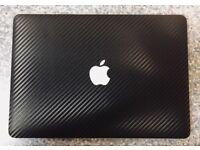 "13"" MacBook Air 2014 with Black Carbon Fibre D-Brand Wrap."