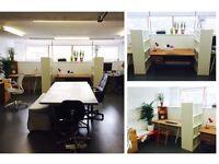 Desk space in warm, peaceful, creative studio.
