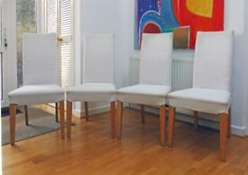 FOUR HIGH-BACK 0FF-WHITE UPHOLSTERED DINING CHAIRS WITH LIGHT WOOD POLISHED LEGS