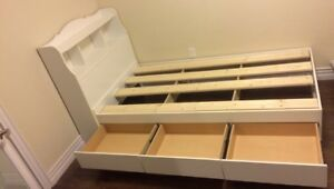Twin bed with shelf headboard and drawers