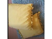 Two Green Square Cushions With Pom Pom Edges